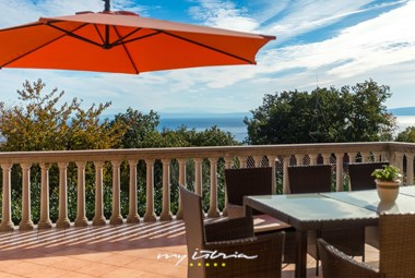 Enjoy the sea view and outdoor dining area in Villa Brajde