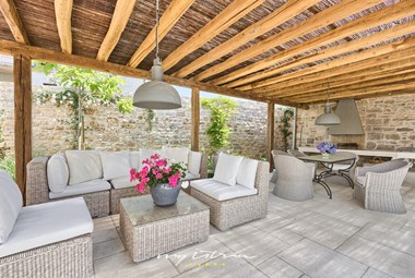 Wonderful outside covered dining area with open fireplace / BBQ