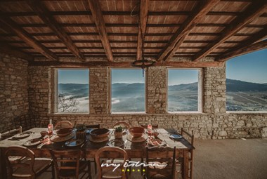 Covered outdoor dining area with panoramic view over the Mirna valley - Villa Angelo in Motovun