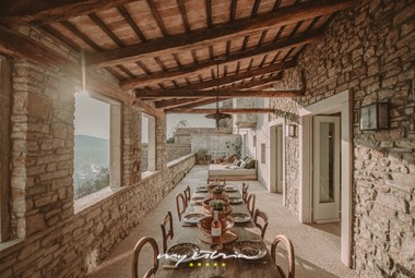 Covered dining area and sun bed under open skies with panoramic view- Villa Angelo in Motovun