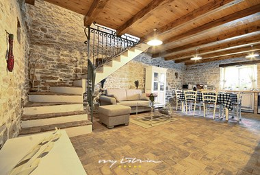 The rustic design of the living area on the ground floor of the 1. house in our villa in Central Istria