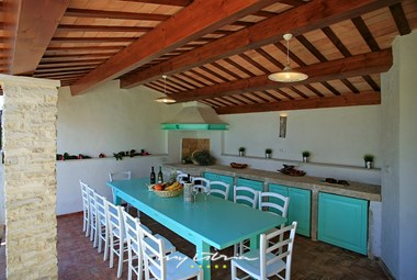 The cosy summer kitchen in front of the 1. house of our villa with pool near Barban