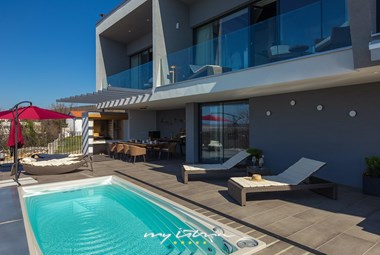 The villa has an outdoor and an indoor pool