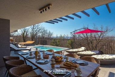 Outdoor dining area is perfect for the summer
