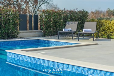 Cosy sun loungers by the pool