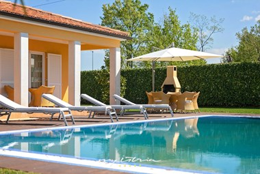 Sun loungers next tot he pool in Villa Commel, Porec