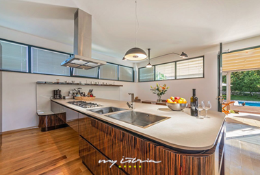 Fully equipped kitchen with balcony doors and direct pool access- Villa Breg