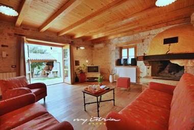 Lovely living room with fireplace in Villa Graziella