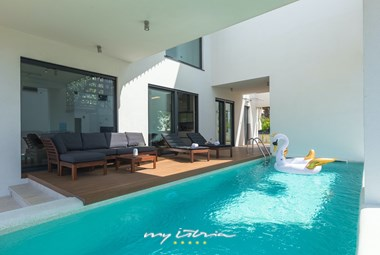 Private pool with sun loungers to unwind and relax in villa Buza