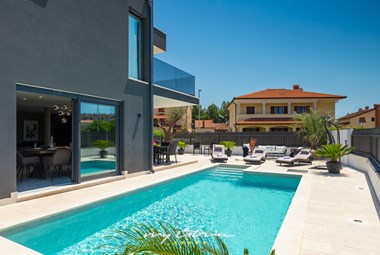 Pool area surrounding modern villa Orion in Rovinj