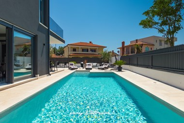 Big private pool surrounded by sun loungers in Villa Orion