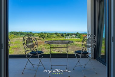 Lovely seating area for two with view of the surroundings in Villa Sunshine Tea