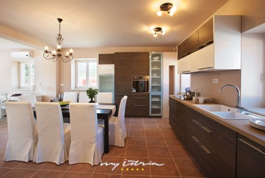 Kitchen with dining area in the villa