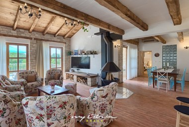 Old-school charm in the big living and dining room of Villa Lipica