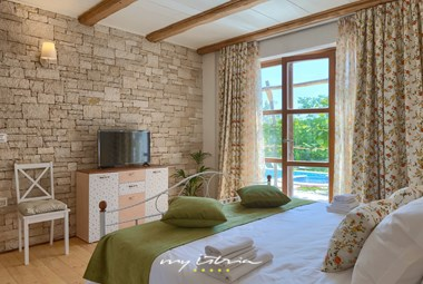 Beautiful, comfortable bedroom with double bed in Villa Lipica in Pazin
