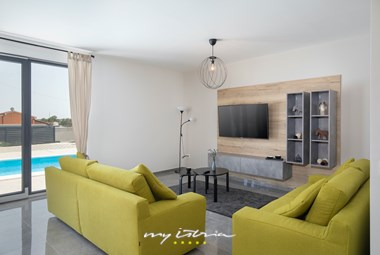 Minimalistic and fresh design of the living room in Villa Perle