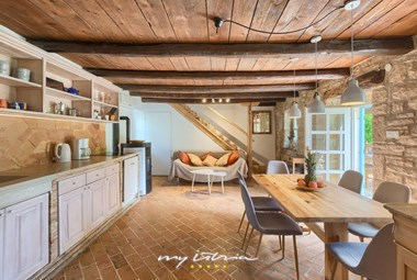 Warm kitchen and living area in Villa Natura