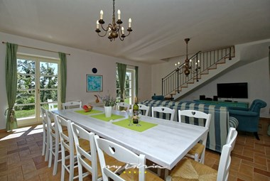 Spacious living and eating area in one of the apartments of Villa Dvori na Brigu