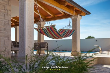 Place to unwind next to the pool a hammock in villa Rafo