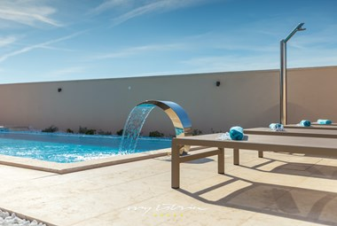 Nice pool with sun loungers and outdoor shower in Villa Rafo in Pula