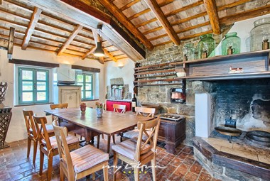 Rustic dining area with fireplace in the villa