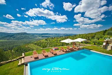 Villa´s private pool with sun loungers and great view
