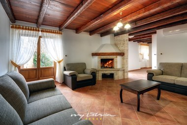 Traditional living room with fireplace in Villa Moncalvo