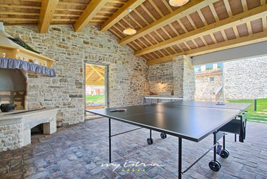 You can play table tennis inT Villa Agra