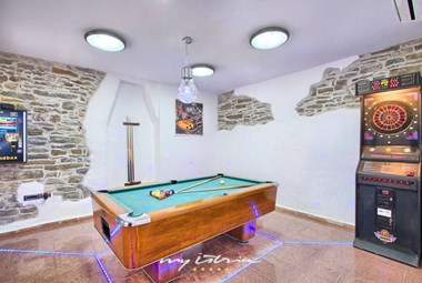 Games room with pool table and darts on the ground floor of the 4th house in Villa Denis