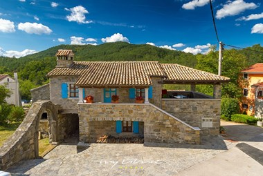 The third stone house with charming blue shutters in our villa with pool