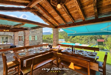 Large outside dining area in our holiday villa in Central Istria overlooking the pool and the landscape