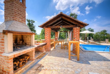 Prepare delicious meals on the barbecue in front of the villa