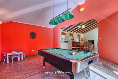For more fun you can play pool table at the villa