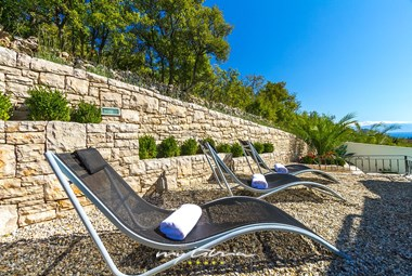 Relax on the sun loungers by the villa´s pool