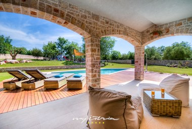 Relaxing terrace and pool area in our villa near Porec
