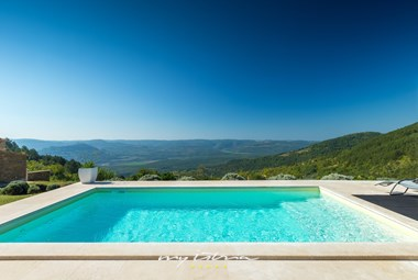From this designer villa extends an amazing view of Motovun