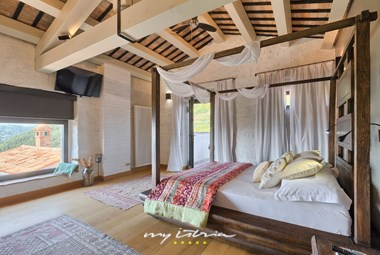 White canopy gives the bedroom in Villa Bencani a romantic note