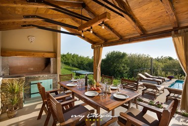 Dine al fresco at villa with pool in Istria