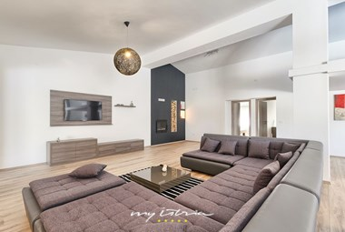 Bright and elegant living room with built in fireplace in villa Matulini