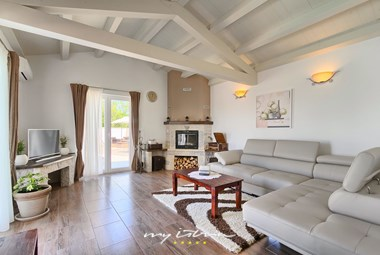 Bright living area with fireplace on villa´s ground floor