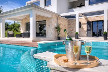 Enjoying by the private pool in our holiday villa in Central Istria