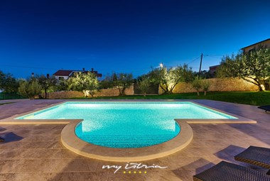 Illuminated pool area in Villa Loverka