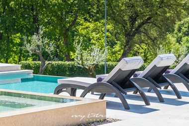 Cosy sun loungers on villa´s pool area
