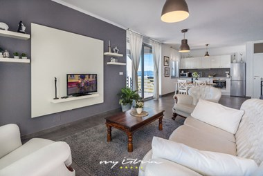 One out of 4 stylishly decorated living area in the villa