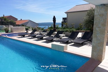 Beautiful large pool in our modern villa  in Kvarner