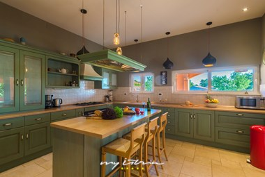 Villa´s spacious and fully equipped kitchen with a practical kitchen island