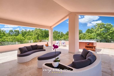 Cosy lounge area on villa´s upper floor is perfect for relaxing