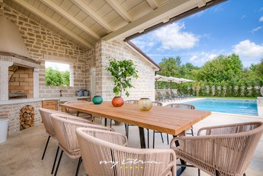 Villa´s outdoor dining area with barbecue in beautiful surrounding