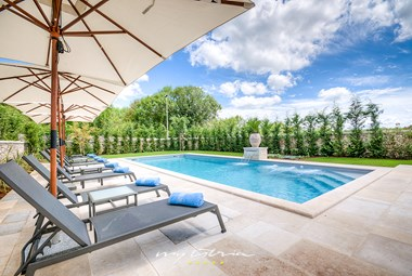 Inviting pool area with sun loungers in Villa Zoe