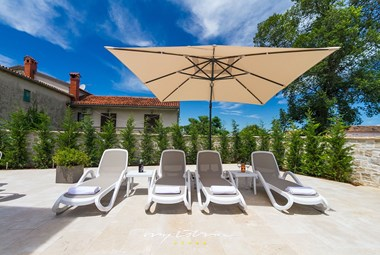 Relaxing sun loungers on the pool area of our villa in Istria